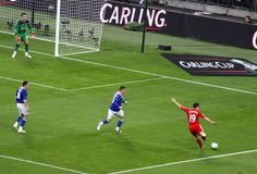Carling Cup final - Downing strike. Moment of  the final of the Carling Cup 2012 between Liverpool FC and Cardiff City, with Downing (n. 19 in red) strikes in Stock Image