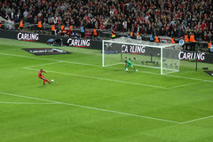 Carling Cup final - Liverpool penalty. The victory penalty by Liverpool Glen Johnson during the final of the Carling Cup 2012 between Liverpool FC and Cardiff Royalty Free Stock Photography