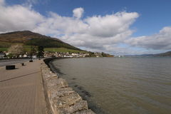 Carlingford Lough, Co. Louth, Ireland. View of the harbour at Carlingford Lough, Ireland. Walkway leading into the small village of Carlingford with mountain in royalty free stock photos