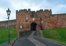 Carlisle Castle entrance, Cumbria, UK. The entrance through the De Ireby Tower at Carlisle Castle in Cumbria United kingdom. 900 years old, the norman castle and stock photo