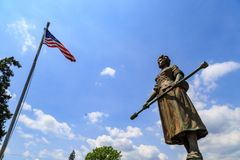 Molly Pitcher Standing with US Flag. Carlisle, PA, USA – June 26, 2016: The Mary Ludwig Hays - better known as Molly Pitcher - gravesite, located in the Old Royalty Free Stock Photography