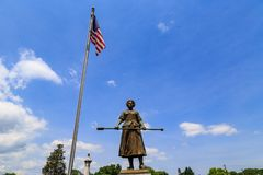Molly Pitcher Statue. Carlisle, PA, USA – June 26, 2016: The Mary Ludwig Hays - better known as Molly Pitcher - gravesite, located in the Old Graveyard Royalty Free Stock Photos