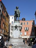 Carlo Goldoni statue, Venice, Italy. 2019. Carlo Goldoni statue. In Venice Italy. On the side are tourists stock images