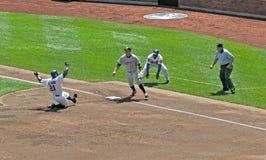 Carlos Delgado slides and re-injures his hip. Stock Image