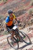 Carlos RIOS; N178 en la acción en el maratón de la bici de montaña de la aventura Foto de archivo libre de regalías