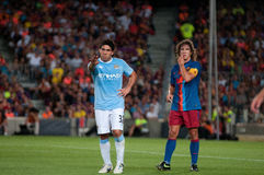Carlos Tevez, Manchester City player, plays against Carles Puyol Stock Photos