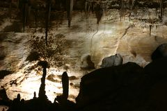 Carlsbad Caverns Stone Formations. Stone formations silhouetted against the lighted wall in Carlsbad Caverns, New Mexico Stock Photos