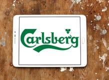 Carlsberg logo. Logo of beer drinks company carlsberg on samsung tablet on wooden background Stock Photography