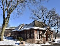 The Carlson Cottage. This is a Winter picture of the iconic Carlson Cottage at the Lincoln Park Zoo located in Chicago, Illinois in Cook County. The stone and Royalty Free Stock Photo