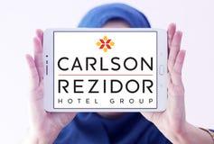 Carlson rezidor hotel group logo. Logo of hotels chain carlson rezidor on samsung tablet holded by arab muslim woman Stock Photos