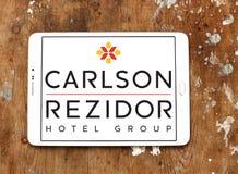 Carlson rezidor hotel group logo. Logo of hotels chain carlson rezidor on samsung tablet on wooden background Stock Photos