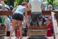 Wine Crush Harvest Festival in Carlton Oregon. Carlton, Oregon,USA - September 12, 2015:Contestants stomp grapes in barrels at Carlton`s annual Wine Crush stock photos