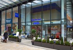 Carluccio`s Deli and Dining Italian Restaurant in Bracknell, England. Bracknell, England - March 20, A woman with a pram passes by Carluccio`s Deli & Dining in Stock Photo