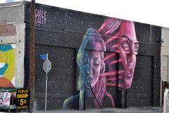 Carly Ealey mural in Los Angeles Arts District. 'Soul Traveler', a mural by Carly Ealey in the Arts District in downtown Los Angeles, USA royalty free stock photography