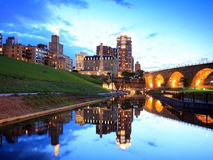 Carlyle condo and Arch Stone Bridge. Reflection of Carlyle condo and Stone Arch Bridge Royalty Free Stock Photography