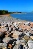 Carlyle Lake Beach Illinois. Rocky southern shoreline and swimming beach of Carlyle Lake in Illinois Royalty Free Stock Photos