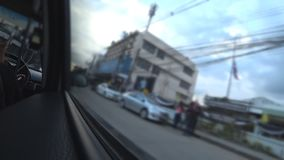 Car moving through city. A forward view from a car driving through a city stock footage