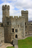 Caernarfon Castle. One of the towers of Caernarfon Castle, located in Snowdonia, north Wales Stock Images