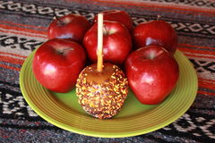 Carmel apple with sprinkles Royalty Free Stock Photography
