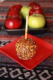 Carmel apple with sprinkles Royalty Free Stock Photos