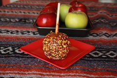 Carmel apple with sprinkles Royalty Free Stock Images