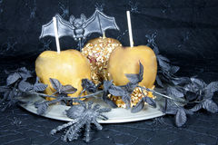 Carmel Apples. Caramel apples on a pewter plate decorated with Halloween themes Stock Images