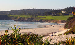 Carmel Beach. People enjoying a beautiful afternoon on Carmel Beach California. A world famous golf course in the background Stock Images