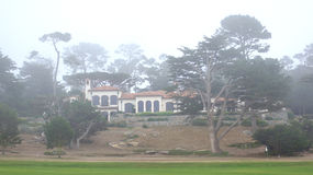 CARMEL, CALIFORNIA, UNITED STATES - OCT 6, 2014: beautiful houses at the Pebble Beach Golf Course, which is part of the. Famous 17 miles drive area royalty free stock photos