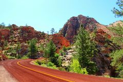 Carmel Highway near Checkerboard Mesa, Zion National Park, Utah. Carmel Highway is winding its way through the desert landscape of the eastern section in Zion stock photography