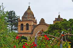 Carmel by the Sea, mission, Mission San Carlos Borromeo, catholicism, garden, flowers, California, church, architecture, cross. Mission San Carlos Borromeo on stock photos