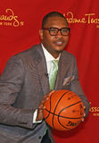 Carmelo Anthony. The real Carmelo Anthony assumes his free throw taking position at Madame Tussauds in New York City on June 26, 2012.   The occasion was the Stock Image