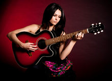 Carmen beautiful woman with guitar Stock Photos