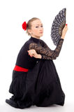 Carmen girl in a dress and a fan Royalty Free Stock Photography