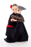 Carmen girl in a dress and a fan Royalty Free Stock Images