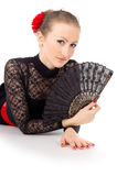 Carmen lying a girl with fan Royalty Free Stock Image
