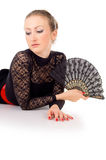Carmen lying a portrait of a girl with fan Royalty Free Stock Images