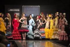 "Carmen Rojo showcases collection at Pasarela Flamenca Jerez 2015. JEREZ DE LA FRONTERA, SPAIN - FEBRUARY 14: Models pictured on the catwalk during the ""Carmen Stock Photos"
