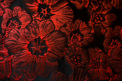 Carmine red flowers pattern on black jacquard fabric. From above Stock Image