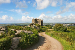 Carn Brea Castle. Road leading to a castle against a dramatic sky Stock Images