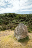Carn Brea. In cornwall, england uk with a view of the monument near redruth. With granite rock in foreground Royalty Free Stock Photos