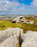Carn Brea Hill Cornwall. Granite outcrops pm top of Carn Brea hill with Redruth in the distance Cornwall England UK Europe Royalty Free Stock Photography