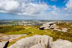 Carn Brea Hill Cornwall. Granite outcrops pm top of Carn Brea hill with Redruth in the distance Cornwall England UK Europe Stock Images