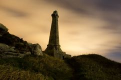 Carn Brea`s Basset monument. The basset monument on top of Carn brea hill in cornwall on a cloudy night Stock Images