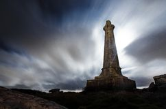 Carn Brea`s Basset monument. The basset monument on top of Carn brea hill in cornwall on a cloudy night Stock Image