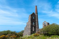 Carn Galver Tin Mine. Steam pumping engine house of Carn Galver tin mine in Cornwall with the Whim engine house beyond, where ore was winched to the surface stock images