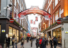 `Carnaby Christmas Revolution` sign on Carnaby Street, London. Stock Image
