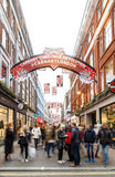 `Carnaby Christmas Revolution` and tourists on Carnaby Street, L Royalty Free Stock Image