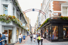 Carnaby street, famous shopping street with people in London Royalty Free Stock Image