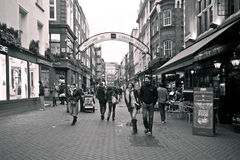 Carnaby street, London. Sepia picture. In London the streets are crowded and people are very active. Carnaby street very popular for shopping and walking among Royalty Free Stock Image