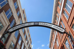 Carnaby Street sign. Looking up into the sun of a Carnaby street sign in central London Royalty Free Stock Photos